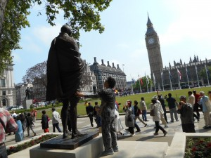 Ghandi contemplates Big Ben, also in the Westminster District of London.