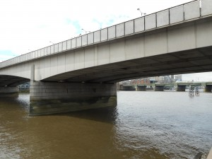 This one is London Bridge. Probably the one in the nursery rhyme fell down! This one is dull and could be anywhere.