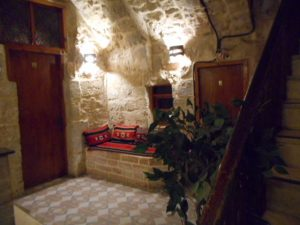 The tiny lobby of The Citadel Youth Hostel in Jerusalem