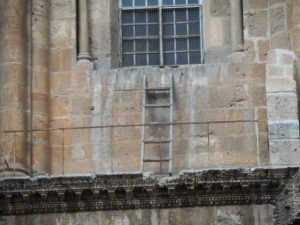 The nine Christian sects controlling the church can't agree to move the ladder some ancient workman left. It's wooden and has been replaced over time, but it's always there. History!
