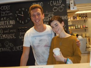 Lucas and Tatiana, behind the front desk.