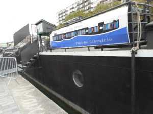 This is a ship on a Paris canal that serves the neighborhood as a library.